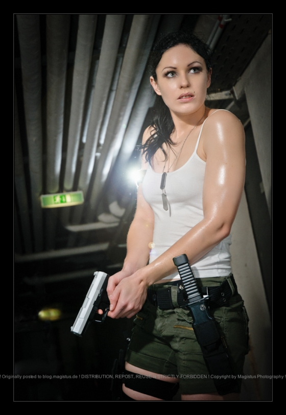 Urban Warfare - Action Girlfight Portrait with Model in tanktop and shorts discovering a dungeon holding a weapon in hear Hands - © by Magistus