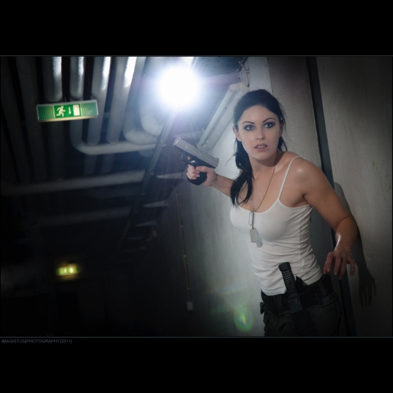The Hunter - athletic and beautiful action Girl searching a dark place wearing a white tank-top with a gun in her hands - Photo © by Magistus