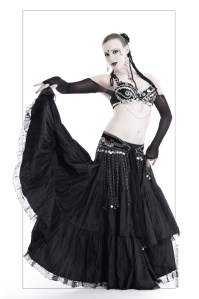 Beautiful model in sexy gothic belly dance outfit wearing a long black skirt and a black bra posing and dancing. © by Magistus