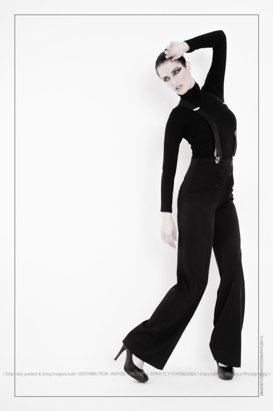 Black Fashion - Shooting with beautiful model wearing black figurehugging trousers and a black top posing very graceful - Photo © by Magistus