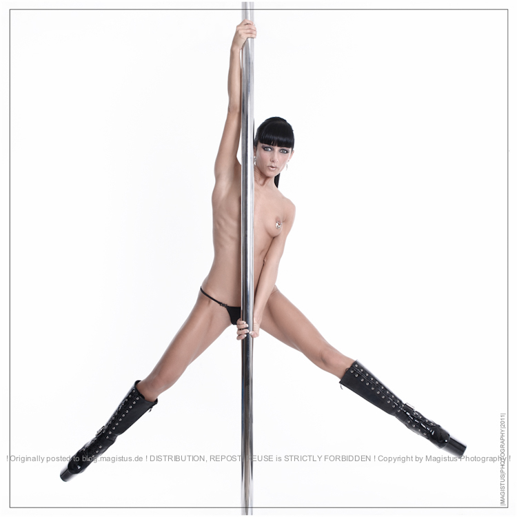 Nude Poledance - Acrobatic Nude Art with super sexy model only wearing a black string and black boots posing topless - Photo © by Magistus