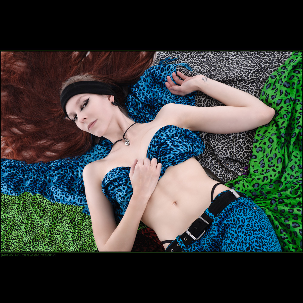 Colorful Leopard - Fantastic model is laying on colorful punk leopard underground wearing leopard jeans topless only covered by a scarf - Photo © by Magistus