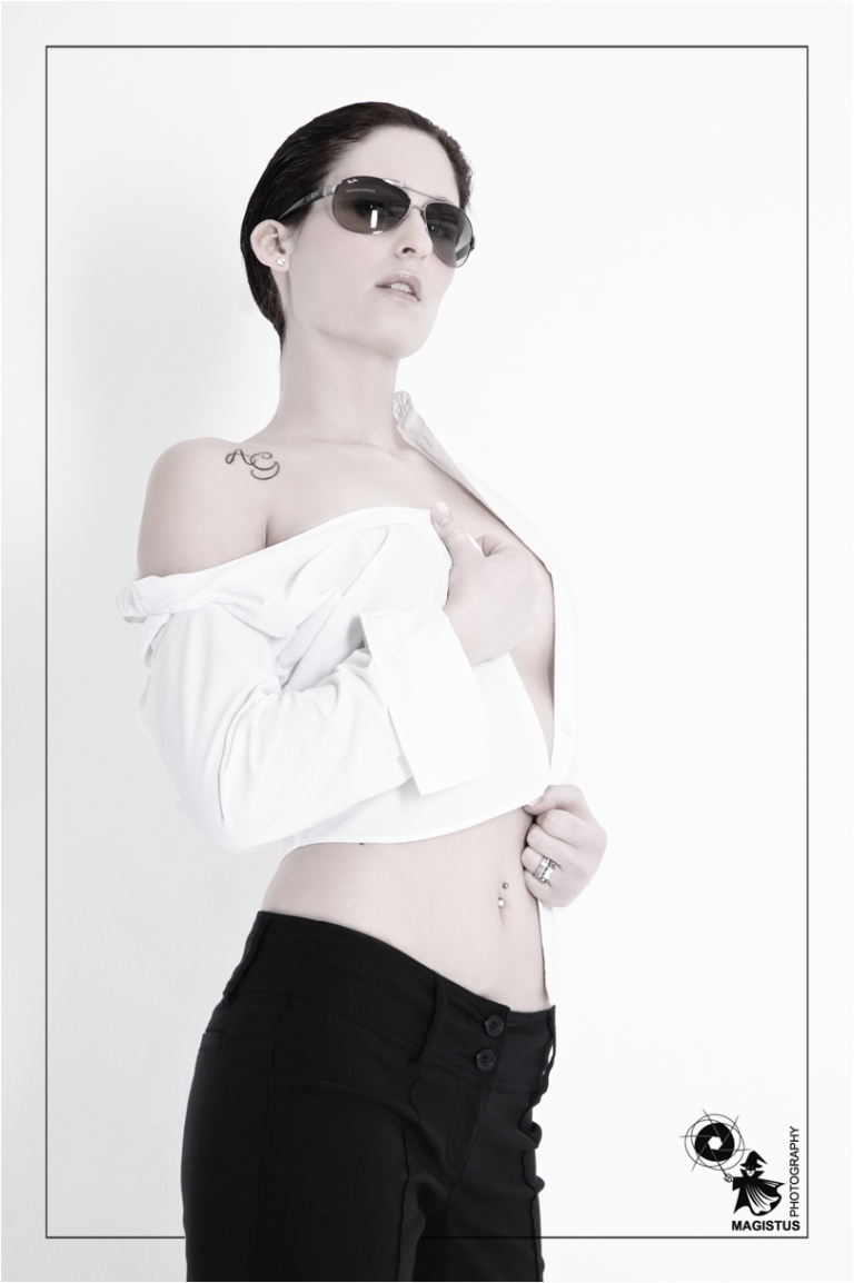 FeMale Fashion - Super model wearing sunglasses and a white white shirt covering her only barely styled in a male look -  Photo © by Magistus