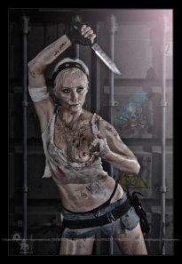 Bio Hazard - Erotic Girlfight Series with a pritty but tough girl posing fighter style with dagger in her hand covered in dirt and blood one breast exposed - Photo © by Magistus