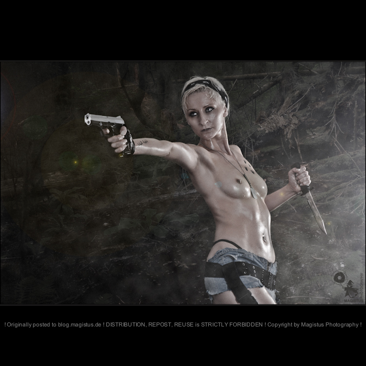 Dschungle Fighter - Erotic nude wetlook Girlfight Shooting with half naked model posing topless in short jeans hotpants wearing a gun - Photo © by Magistus