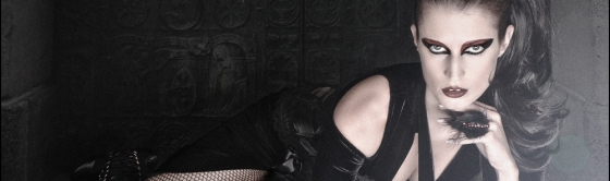 Gothic Beauty - Dark Fashion Composing with beautiful model lying on the floor in front of a ancinent gate wearing a black sexy dress with dark make-up styling - SMALL HEADER © by Magistus