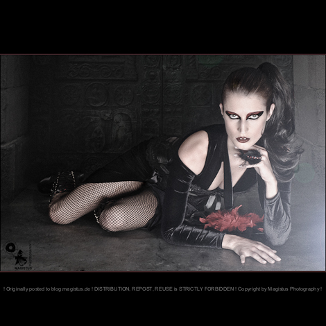 Gothic Beauty - Dark Fashion Composing with beautiful model lying on the floor in front of a ancinent gate wearing a black sexy dress with dark make-up styling - © by Magistus