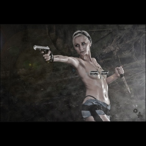 Dschungle Fighter - Erotic nude wetlook Girlfight Shooting with half naked model posing topless in short jeans hotpants wearing a gun - CENSORED Photo © by Magistus