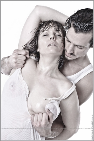 Rough - Hot and erotic love scene with a femal and male model posing very sexy in wet look triying to ripp of her shirt