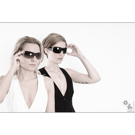 Cool Fashion - Girl/Girl Portrait of two beautiful models with Sunglasses wearing black and white tops - © by Magistus