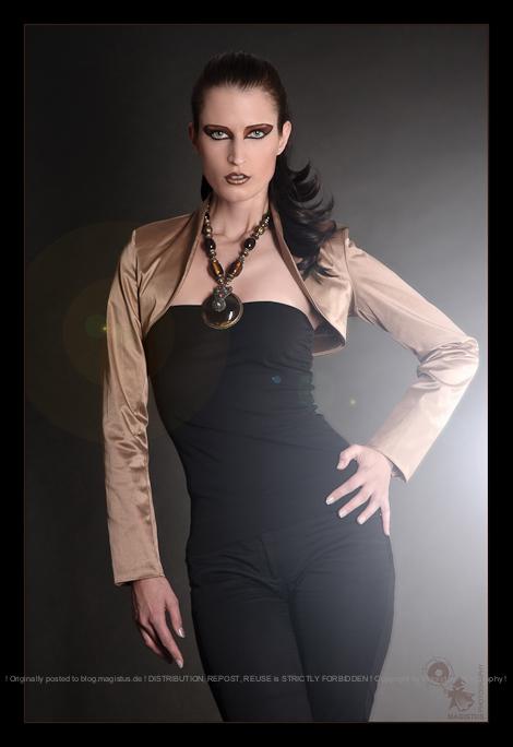 Modern Fashion - Classic Fashion Photoshooting with beautfiful posing model wearing a golden bolero top, black jeans and black shirt. - © by Magistus