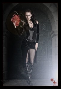 Gothic Catwalk - Gothic Fashion Composing with stunning model wearing a sexy black outfit with tight corsage walking to the camera - © by Magistus