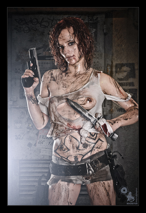 Fighting in the Streets - Erotic Girlfight Shooting with sweet model covered in dirt posing with a gun and dagger wearing dirty and dight jeans hotpants and a ripped off shirt showing her naked pierced tits - © by Magistus