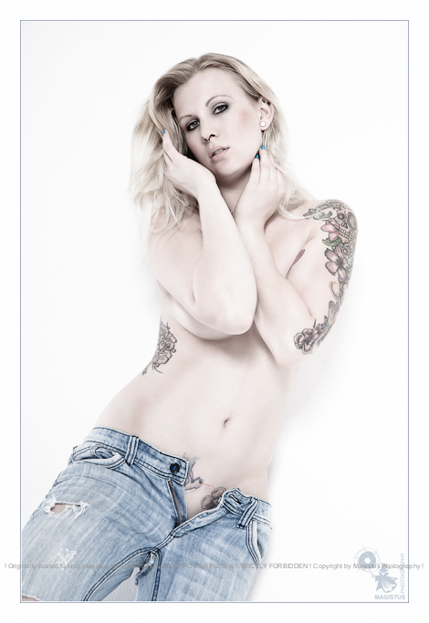 Jeans n Tattoos  - Sexy Nude Portrait with beautiful tattoo model posing in tight half opened jeans and topless in front of a white wall. - © by Magistus