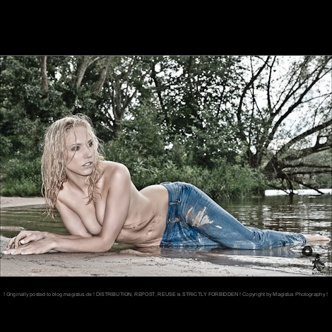 Wet Jeans - Erotic Beach Beauty Photoshooting with beautiful model posing on the beach topless and half naked wearing wet tight blue jeans. Beautiful, sexy and really hot Photoshooting.  - © by Magistus