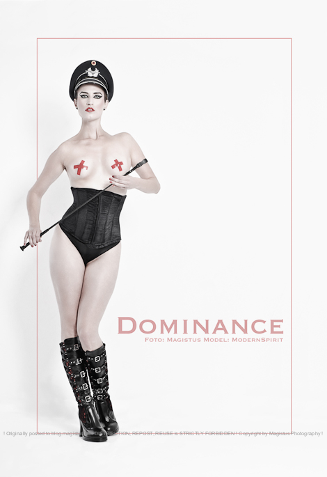 DOMINACE - Stylish and Erotic Fetish Shooting with super Model posing half naked with a whip in her hands wearing a military hat, black corsage, panties and boots, her boobs only covered by small red tape crosses.  - © by Magistus