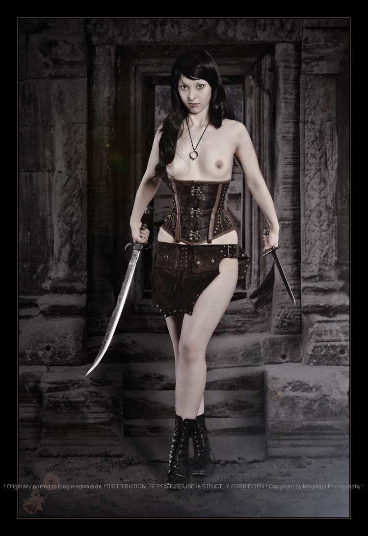Temple Fighter - Erotic Figthergirl Shooting with topless and beautiful warrrior model wearing leather corsage and two blades posing half naked in front of an ancient temple - UNCENSORED © by Magistus