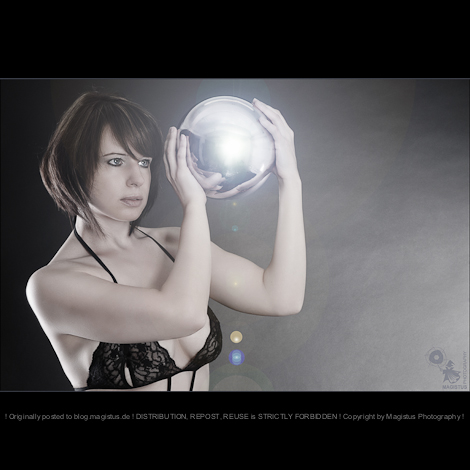 Light Ball - Beauty Lingerie Portrait with beautiful model holding a shiny metal ball in her hands wearing sexy black lingerie - © by Magistus