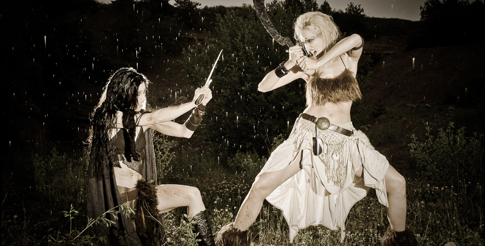Fight in Rain - Amazon Shooting in the Rain with two great sword fighting models wearing sexy leather tops and short skirts - © by Magistus