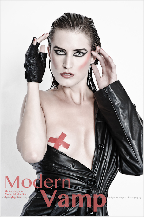 Modern Vamp - Stylisch, tough & sexy Photoshooting with really amazing model styled with great make-up and hair wearing black leather jacked showing her left breast covered only by red tape. - © by Magistus