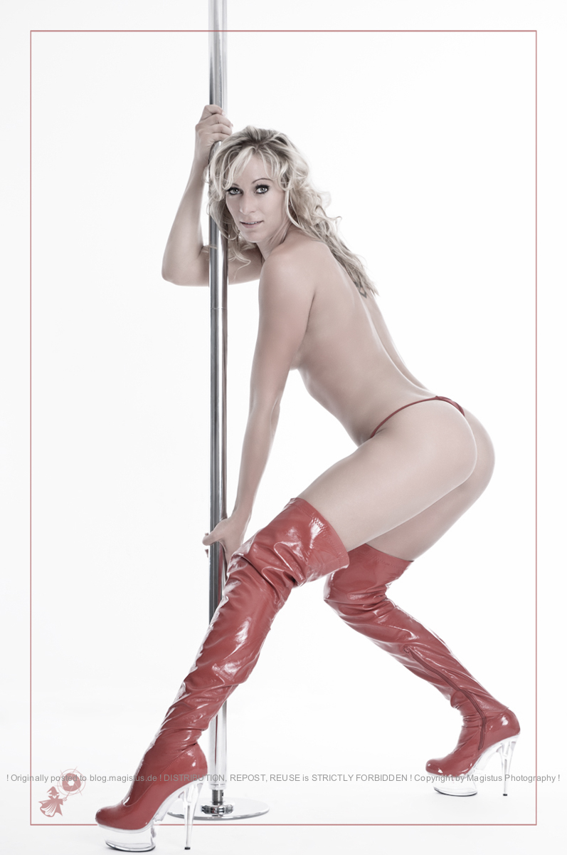 Sexy Pole Dance - Erotic Nude Art Shooting with atheltic and sexy model Tine Sienna posing naked at a pole wearing very high red boots and a tiney red g-string. - © by Magistus