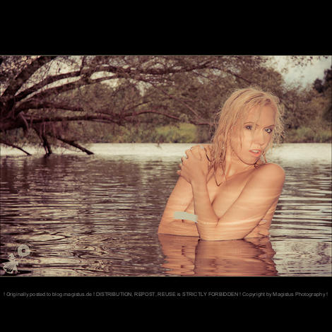 Mermaid - Nude Art Water Shooting with beautiful blonde model posing in the water covering herself with her arms showing of her right naked breast. A really hot and sexy portrait. - © by Magistus