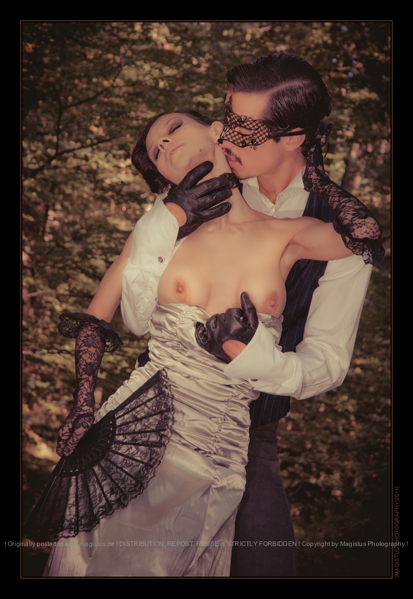 Love Nobless - Erotic Boy-Girl Outdoor-Shooting with a masked gentleman ripping of the dress of a beautiful woman exposing her boobs leaving her topless in his hands. - © by Magistus