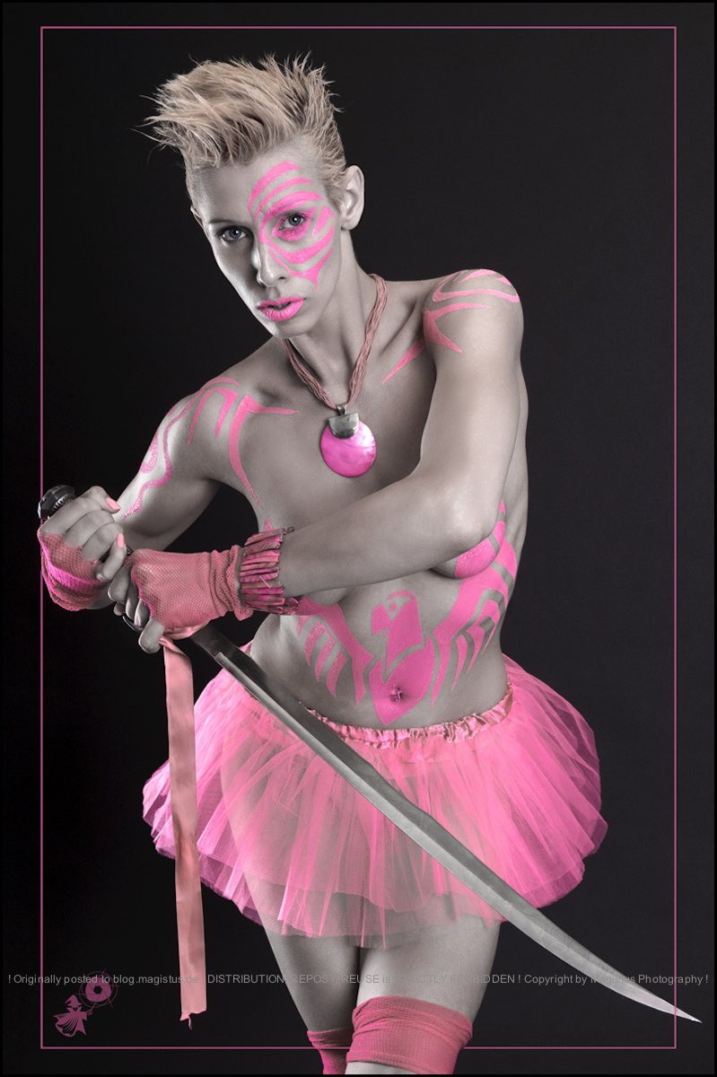 Pink Fighter - Bodypainting with beautiful model posing topless with a sword with a pink painted eagle on her skin. - © by Magistus & Rames