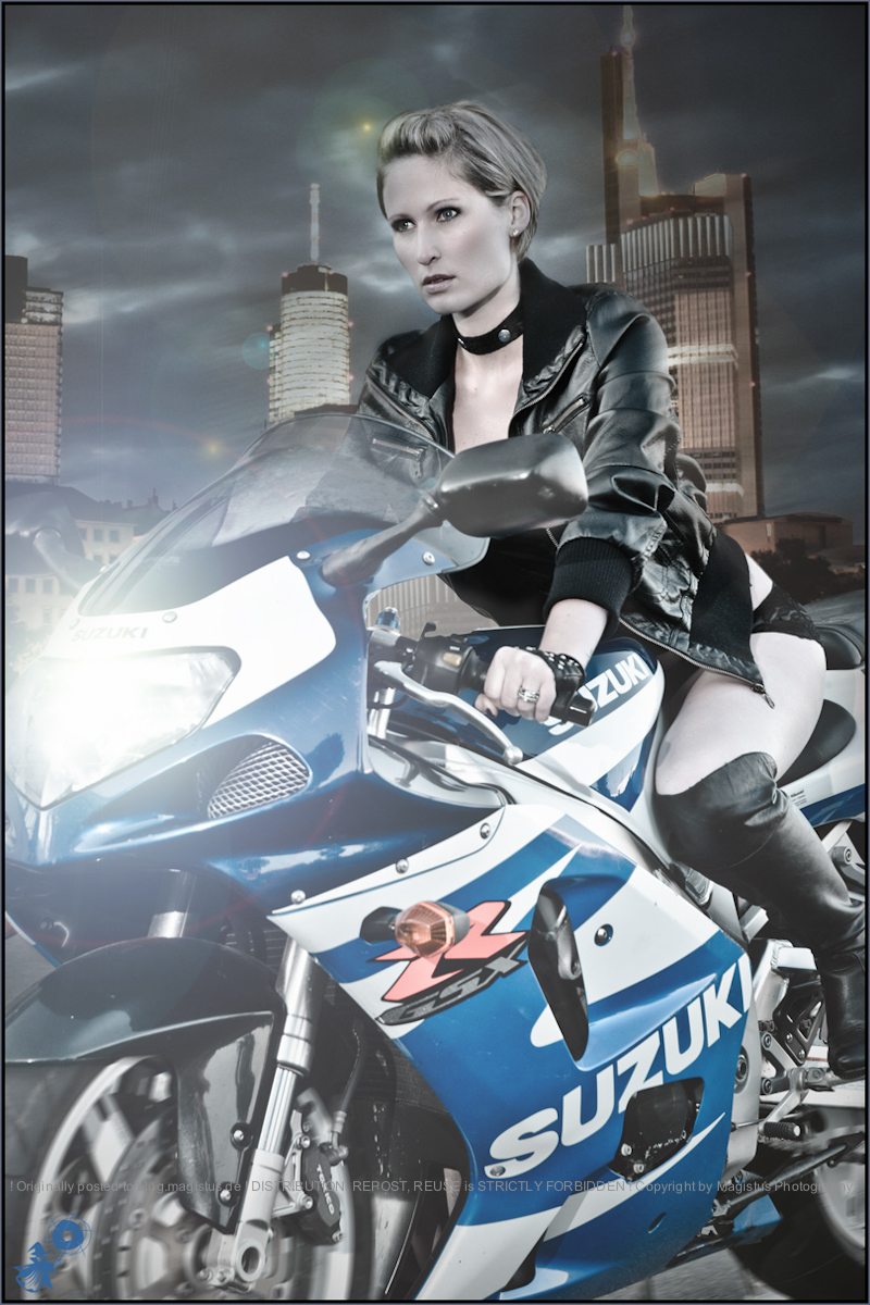 City Racer - Lingerie Motorcycle Action Composing with beautiful tough model driving a large motorcyle through the city wearing a leather jacket and lingerie. -  © by Magistus