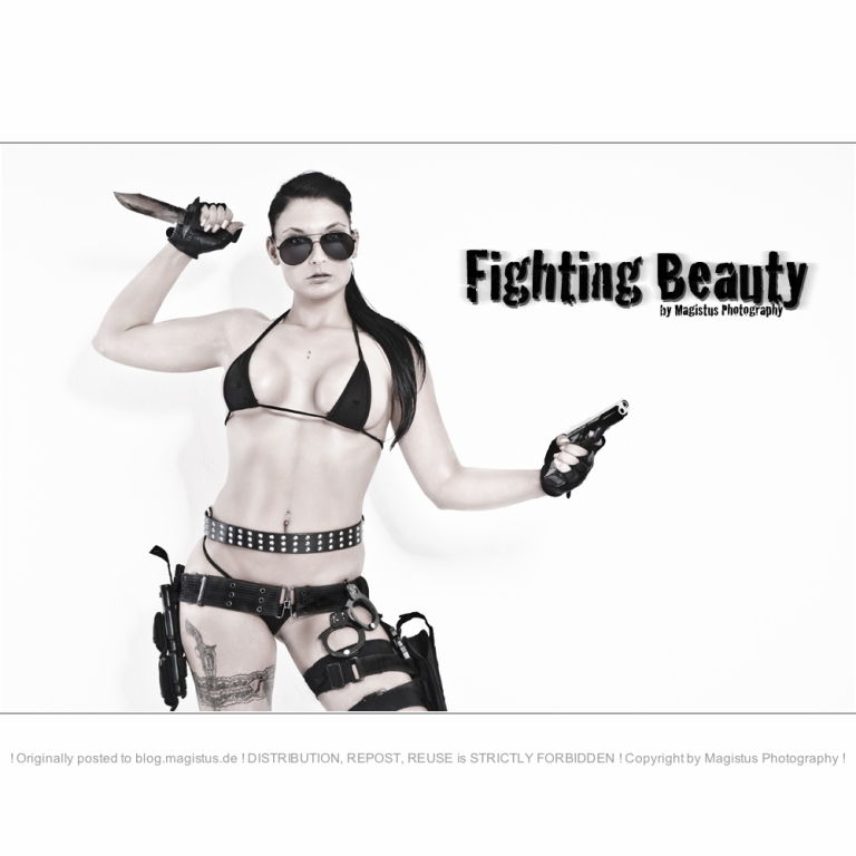 Fighting Beauty - Sexy Fightergirl Photoshooting with a super hot girl posing in a very tiny minibikini showing a lot of skin and big boobs posing with a dagger and a pistol looking tough through sunglasses.  - © by Magistus