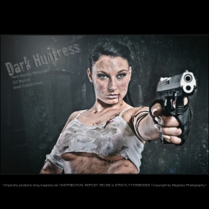 Dark Huntress - Erotic Fightergirl Composing with busty and mega hot model posing covered in dirty with a gun in a dark place wearing a wet and dirty tank top covering only a half of her big boobs. - © by Magistus