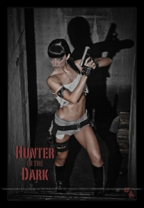 Hunter in the Dark - Sexy OnLocation Shooting with beautiful model posing with a gun in a dark staircase wearing a dirty white tank top and hot jeans hot pants showing her perfect belly. - © by Magistus