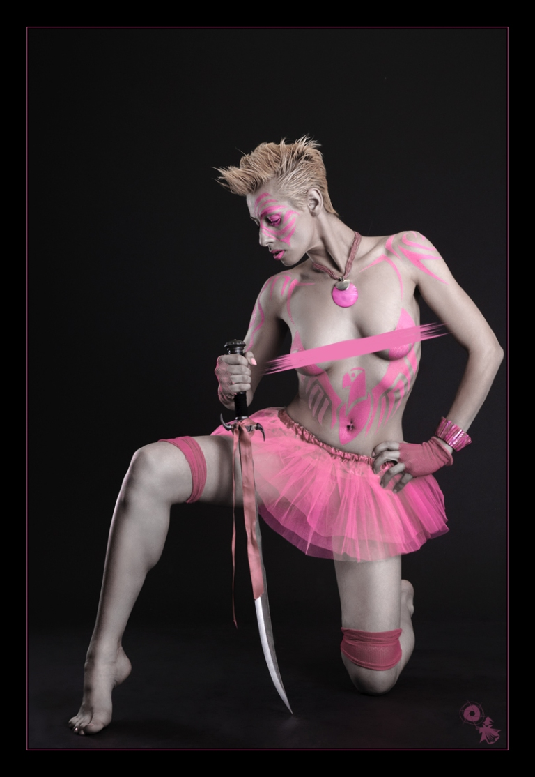 Pink Eagle - Bodypainting Fighter Shooting with a cool and hot model posing naked and topless with a sword covered only slightly by a painted pink eagl- © by Magistus