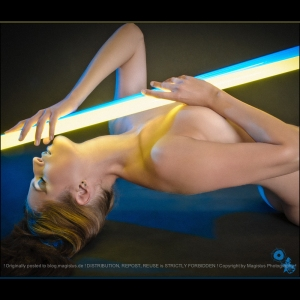 N-E-O-N - Nude Art Photoshooting with great naked model posing with color neon light tubes - © by Magistus