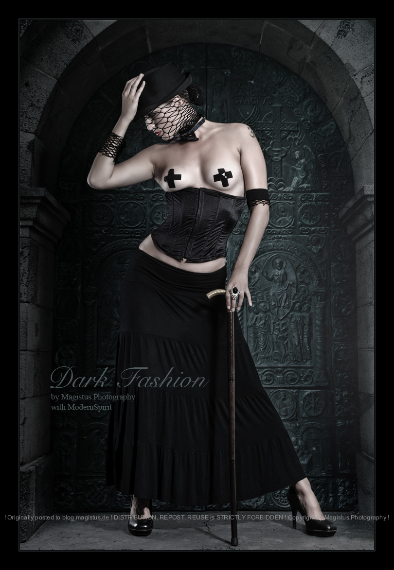 Dark Fashion - Erotic Art Shooting & Composing with fantastic model posing topless in a dark corsage and skirt with a hat and a mask her boobs only covered by small black crosses. - © by Magistus