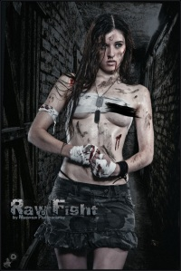 Raw Fight - Erotic Fightergirl Shooting with a beautiful girl posing half naked with dirty on her skin in a dark dungeon wearing a campouflage mini-skirt covering a her beautiful boobs only barely with a pice of dirty cloth showing one naked breast. - © by Magistus