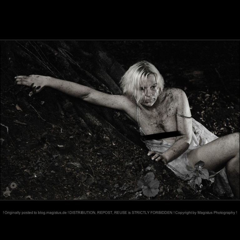 Hunted - Dark Erotic Outdoor Shooting with beautiful topless girl hiding and covered in dirt showing her tits because of her ripped off white and dirty skirt. - © by Magistus