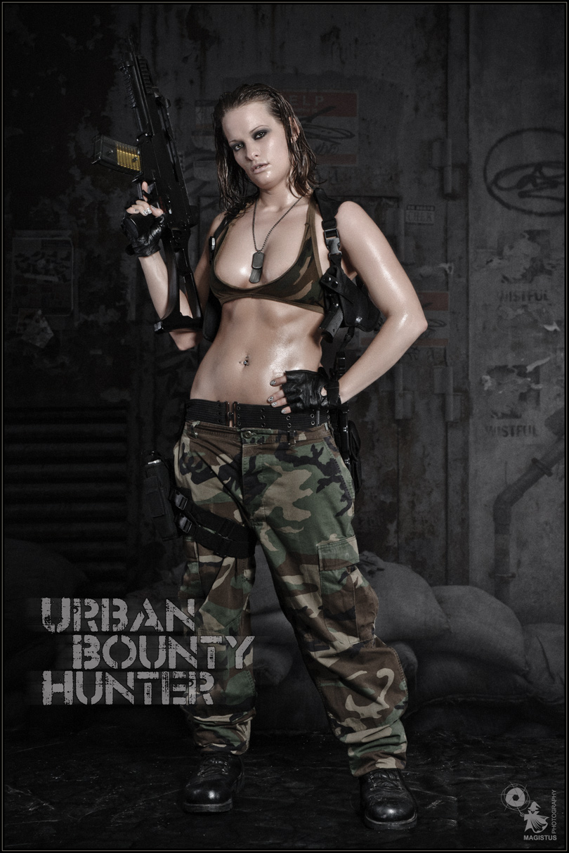 Urban Bounty Hunter - Sexy Fightergirl Shooting with a beautiful busty and sexy girl wearing camouflage pants and a tiny tanktop with a machine gun in her hands posing tough and sexy. - © by Magistus