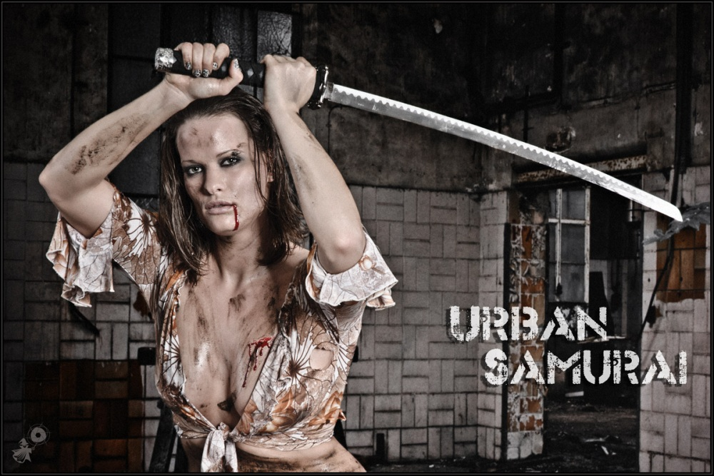 Urban Samurai - Sexy Dirtylook Fightergirl Shooting with a super beautiful busty model with a big cleavage posing with a samurai sword wearing a dirty wide open top. - © by Magistus