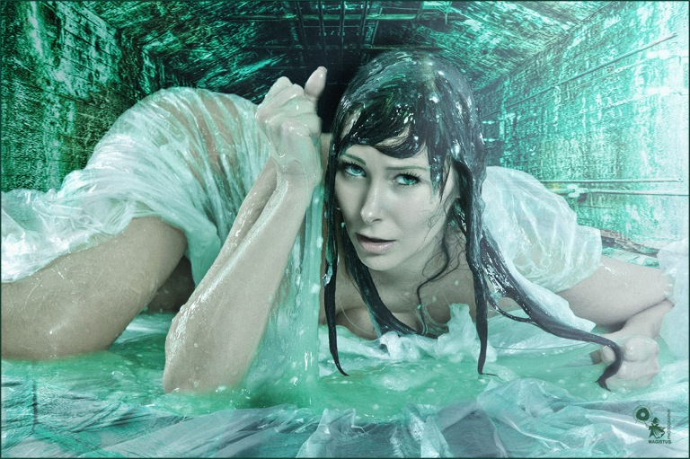 Alien Dungeon - Super sexy and nude model is posing in green slime in a dungeon - Artwork © by Magistus - Background Image © by Grischa Georgiew - Fotolia.com