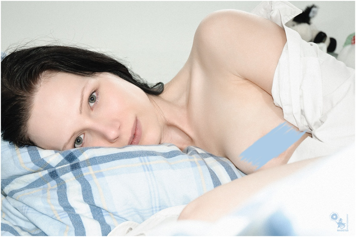 Simply Natural - Nude Art Portait onLocation with a beautiful topless girl in the bed - © by Magistus