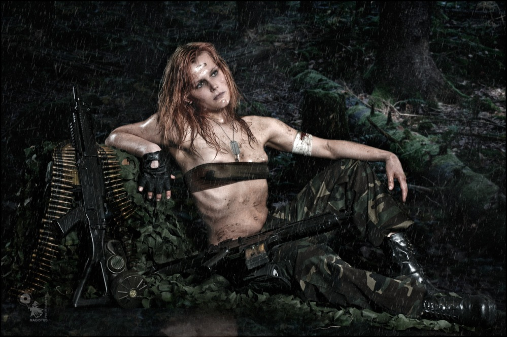Fighters Rest - Erotic Fightergirl Composing with a sexy girl wearing a half transparent top showing a lot of skin covered in dirt sitting in the rain with weapons around her.  - © by Magistus