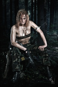 Resting Fighter - Erotic Army Fightergirl Series with a girl resting in the woods wearing camouflage pants and a tiny top with dirt and mud all over her half naked body. - © by Magistus