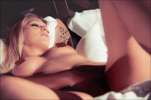 Erotic Art: Dreaming Pleasure - Nude Erotic Shooting with perfect naked model in the bed wide spread dreaming showing her beautiful boobs and piercings leaving you with your fantasy - © by Magistus