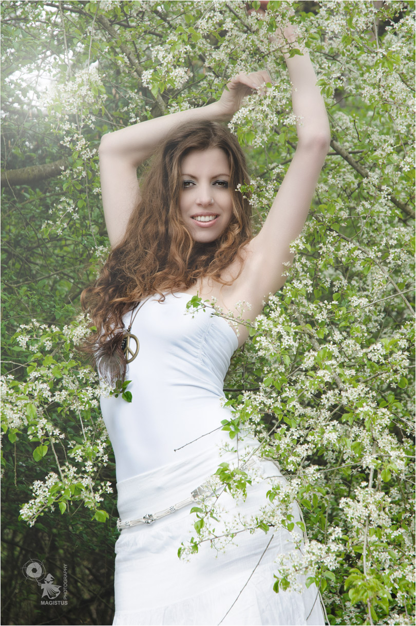 Spring Time - Beauty Portrait in Nature with a fantastic model dressed in white posing in flowers - © by Magistus