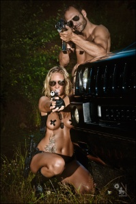 Gun Fight - Erotic Art Fighter Shooting with a half naked girl and a guy posing with guns hiding behind a Hummer. - © by Magistus