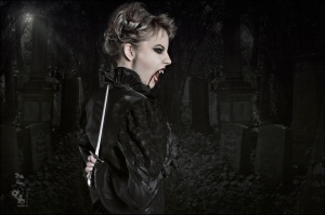 Vampire - Fantasy Composing of a great horror vampire girl with a dagger in her hands hidden behind her back standing in a graveyard - © by Magistus