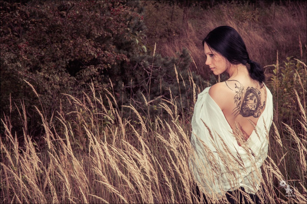 Summer Tattoo - Beautiful Summer Portrait with wonderful model showing beautiful tattoo between her naked shoulder - © by Magistus