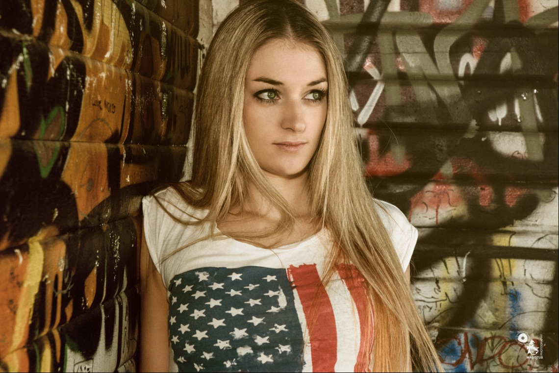 American Girl - OnLocation Portrait CloseUp with a beautiful blonde girl wearing a shirt with stars and stripes.  - © by Magistus