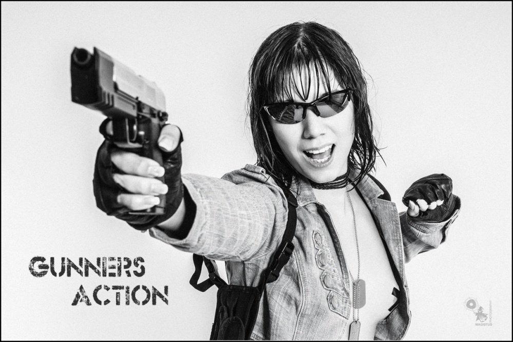 Gunners Action - Sexy Action Photoshoot with topless girl screaming and pointing with a gun. - © by Magistus